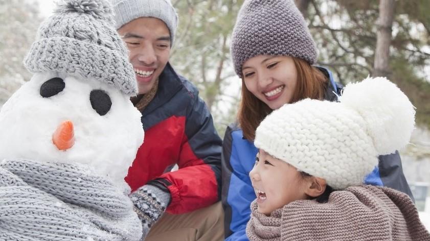 family making a snowman