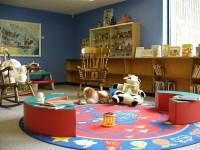 Photo of a children's play room with toys and a play mat